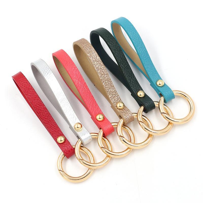 Moda Cuoio Wristband chiave portachiavi Donne Bambine auto incanta il supporto chiave catena del telefono Shell Pendant Bigiotteria Portachiavi Accessori Anello