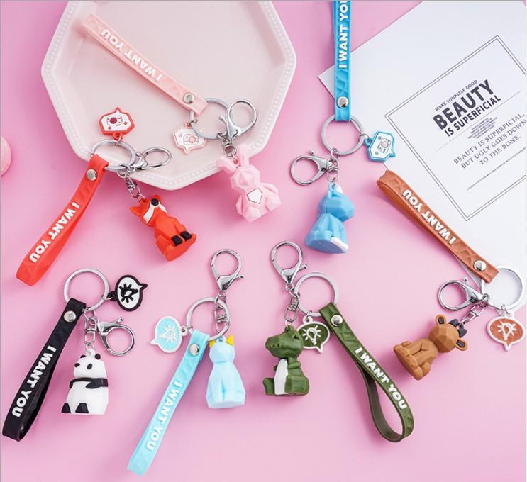 PVC géométrique Cartoon drôle Keychain de dinosaure porte-clés femmes Bijoux Sac mignon breloque porte-clés clés de voiture Accessoires Bague