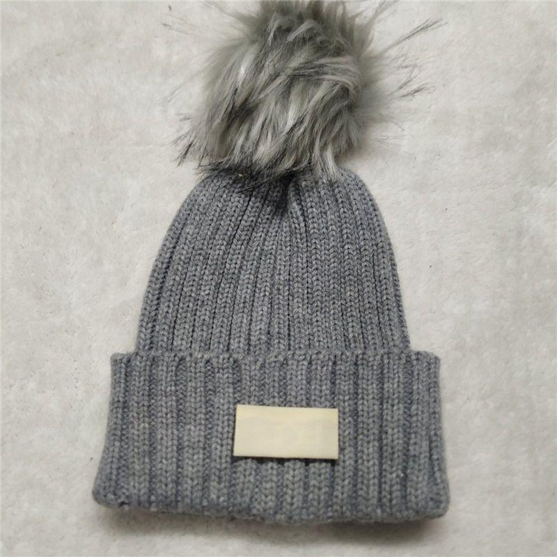 جديد بوم شتاء جديد دافئ الصوف قبعة مصمم محبوك المرأة القبعات الساخنة بيع العصرية بيني شحن مجاني