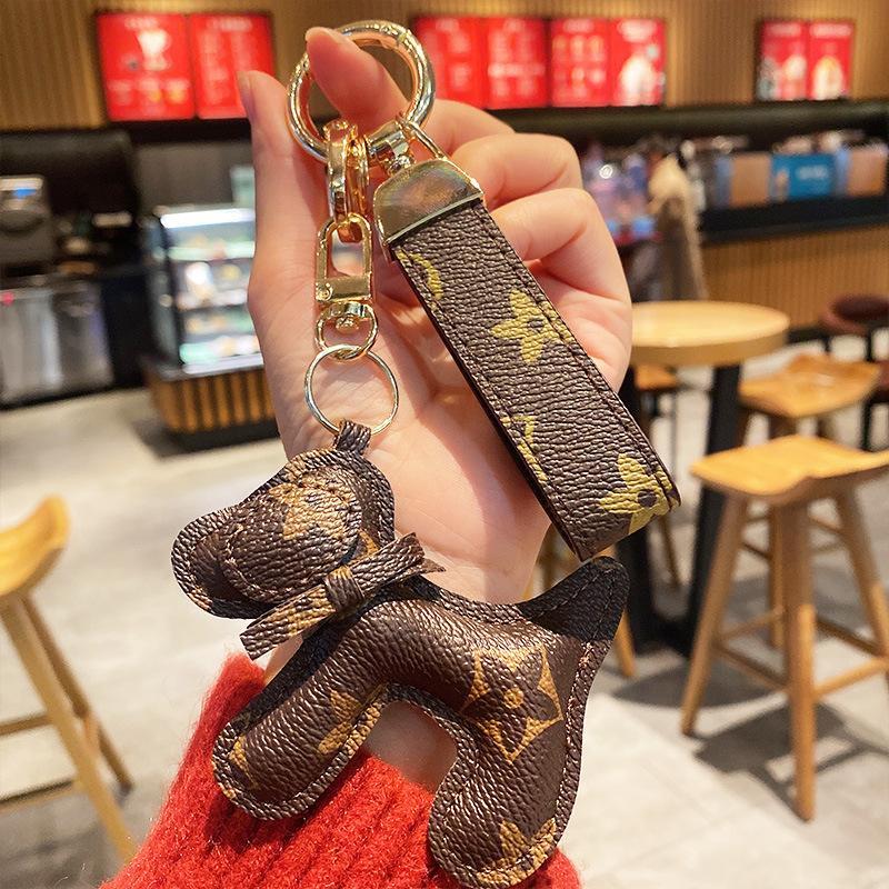 Moda Pu Couro Animal Chaveiro Presente Presente Dog Design Chaveiro Bolsa De Flores Pingente Charme Jóias Keyring Holder para Mulheres Homens Acessórios
