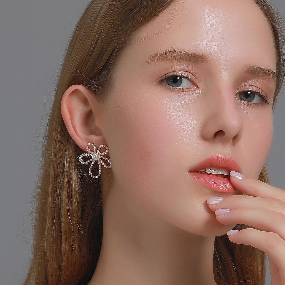 S925 ago d'argento barocco orecchini della perla del fiore semplice e graduale taglio dolce fuori orecchini piccolo fiore fresco orecchini vento