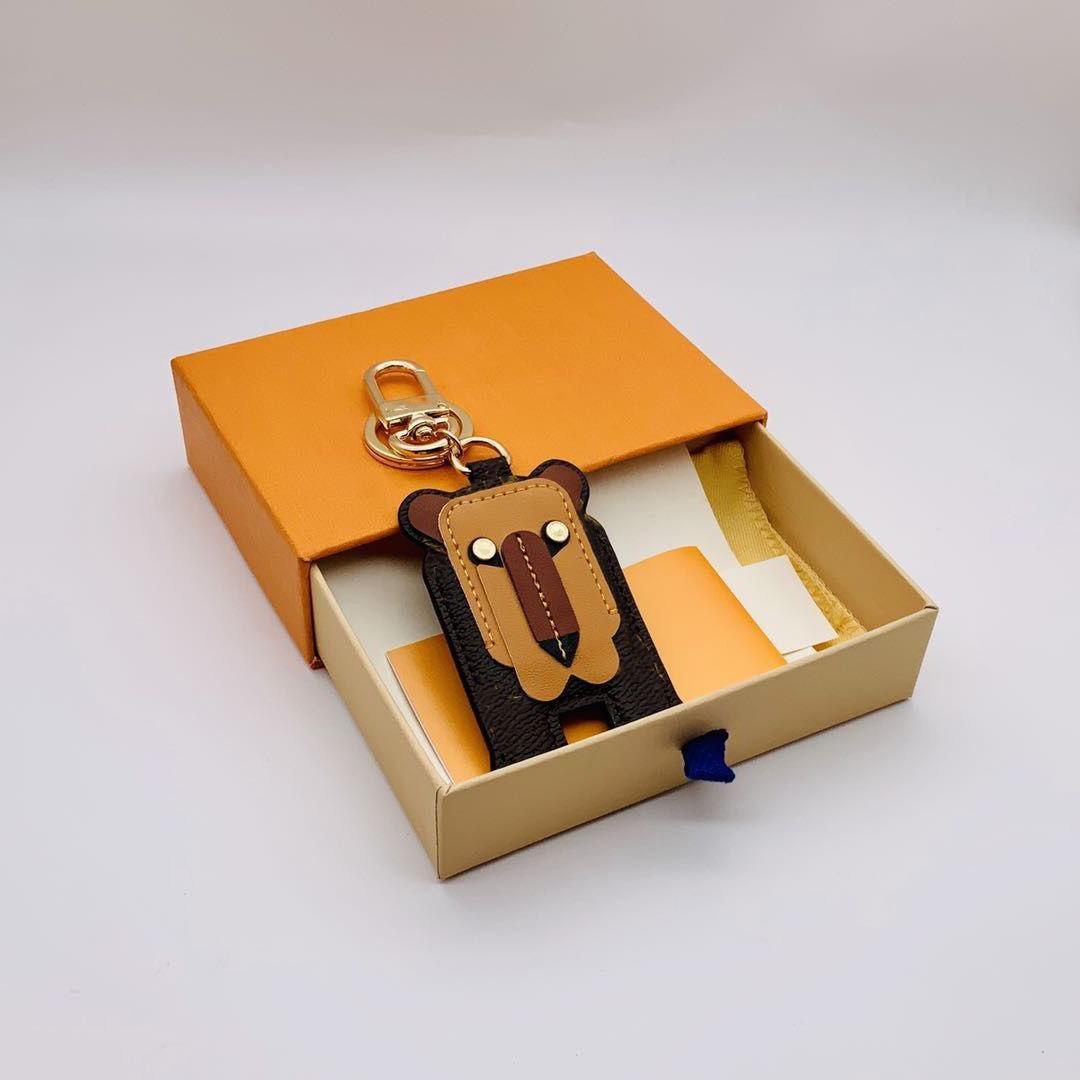 Männer Mode 2021 Design Keychain Brieftasche Kasten Auto Staubbeutel Frauen Designer Lion Schnalle Schlüsselanhänger Handmade und mit Taschen Schlüssel Leder Kette DSAE