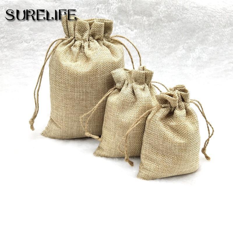 50 unids / lote Vintage Bolsos naturales del regalo de la arpillera de la vendimia bolsas de regalo de los caramelo Favor de la boda Favor de la boda Joyería del cordón de la joyería del embalaje de la joyería