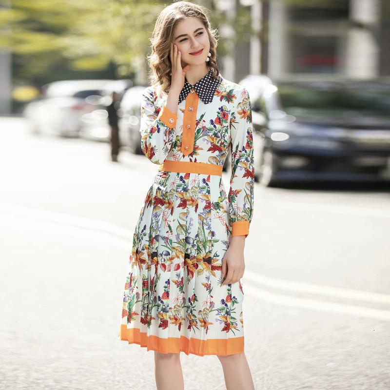 Bohême Impression Fleurs Long-poitrine monocontrie Côté élégant Tempéramment Chemise Robe de printemps Vêtements pour femmes Wagu