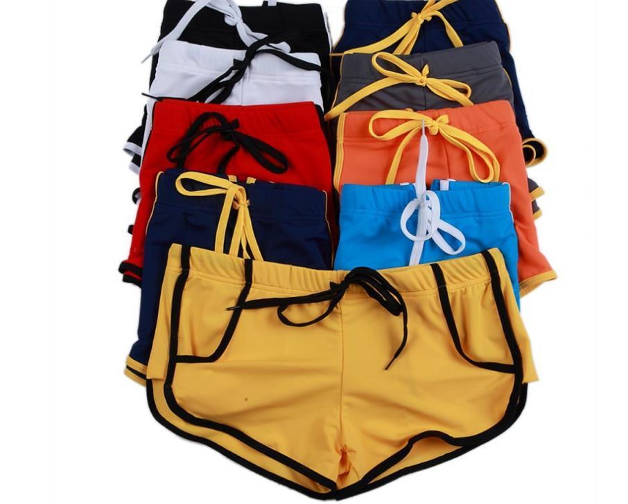 Großhandel-sommer mode marke männer sexy bauchbeutel nieten mini boxer schwimmen / homosexuell Fitnessstudio Schwimmstämme / Strandkarten Shorts