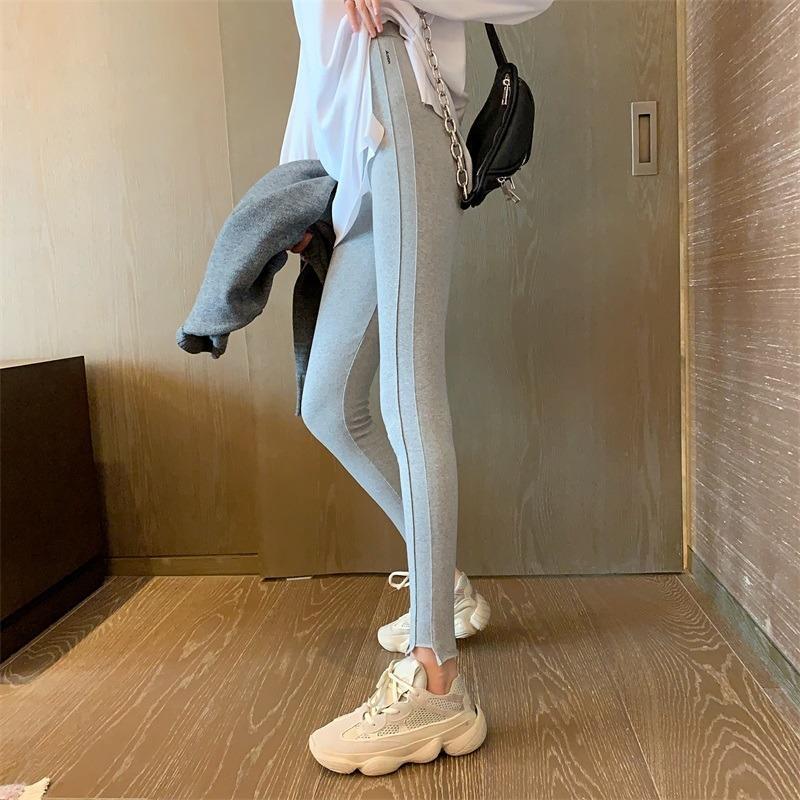 O novo outono e os leggings de inverno das mulheres da cintura alta usam calças ocasionais do estiramento do lápis