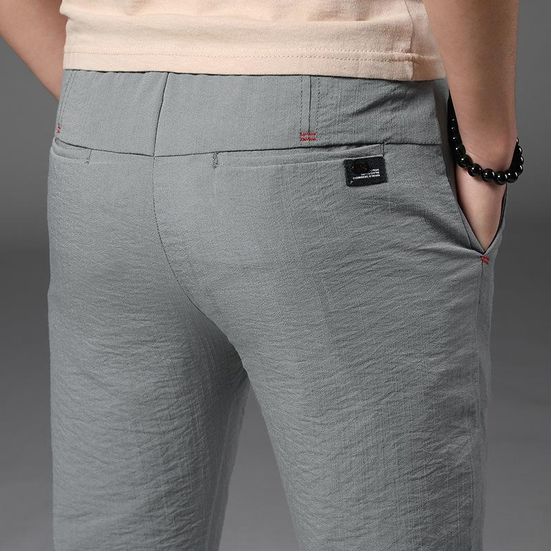 USlOW casual fashion men's fit spring Capris slim summer small feet trousers Casual Korean pants men's pants sn5yZ