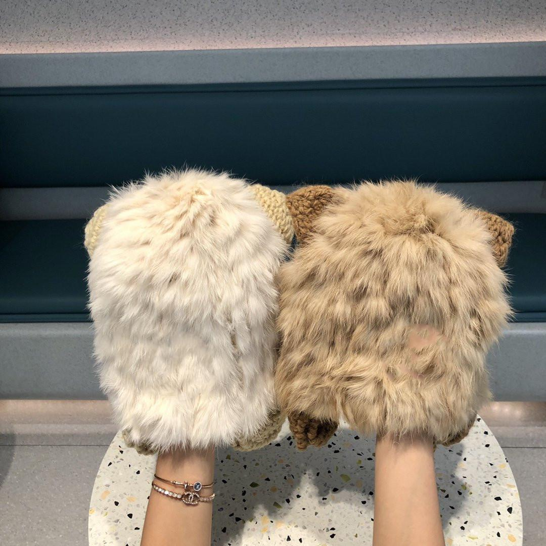 2020 nuevo sombrero de piel estilo del otoño y el invierno femenina del todo-fósforo sombrero de lana de oreja de gato lindo conejo de piel de punto marea envío libre del sombrero