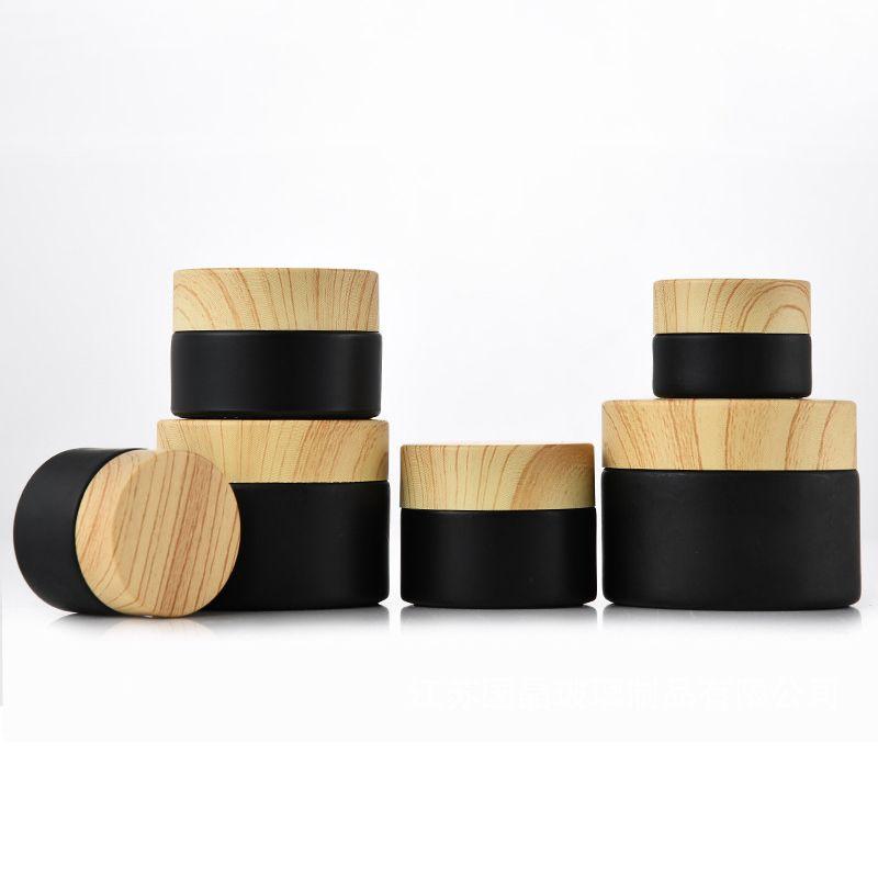 الجملة الأسود متجمد الزجاج الجرار مستحضرات التجميل الجرار مع خامة الخشب البلاستيك الأغطية PP بطانة 5G 10G 15G 20G 30G 50G الشفاه زجاجات التعبئة