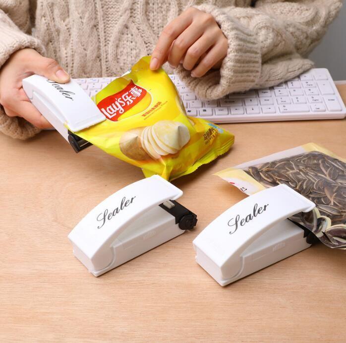 Del sellador de calor Mini calor sellado de la máquina de embalaje del sello del sellador bolsa de plástico portátil de impulso de presión Viajes mano del ahorrador del alimento FWB2811