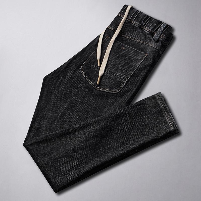 الرجال جينز الخريف الشتاء الأسود الرجال الأزياء السببية الدينيم مرونة الخصر السراويل مستقيم