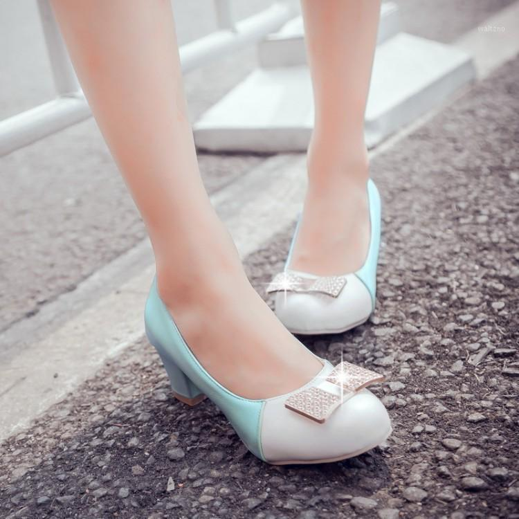 Oversized ladies high heels women shoes woman pumps Metal decoration of round head, shallow mouth and thick heel socket1
