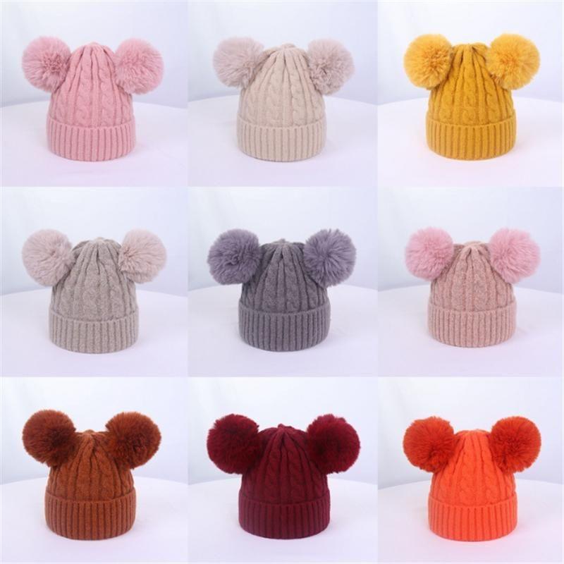 Крышки шапки милая зима теплые младенческие рожденные дети шерстяные вязаные шапка шансы с двумя двойными пома для мальчиков девочка 1-3 года
