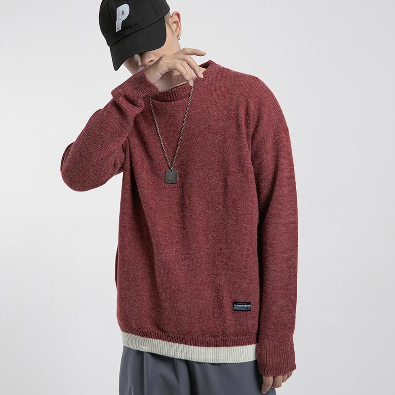 Suéteres de los hombres El suéter de pull-sobre el collar redondo del otoño 2021 está en color sólido y suelto con mangas largas