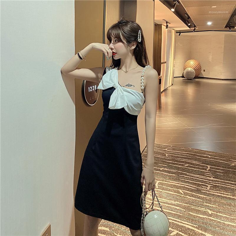 Повседневные платья bodycon платье женщины карандаш прямые черно-белые без рукава жемчужный ремешок лук ночной клуб клуб вечеринка элегантные платья1
