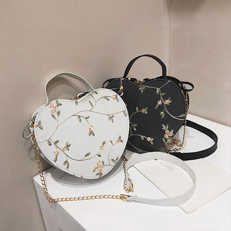 Сумка Женщины в форме сердца 2020 Новый корейский моды кожаная сумка Lady Handbag Сладкие девушки Цветы сумки на ремне