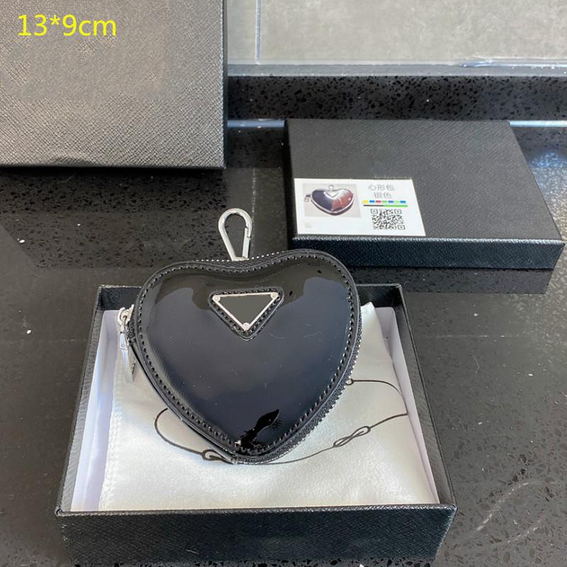2021 뜨거운 디자이너 미니 하트 지갑 여성 동전 지갑 소녀 브랜드의 새로운 미니 심장 지갑 귀여운 패션 변경 가방 상자 PD21020201
