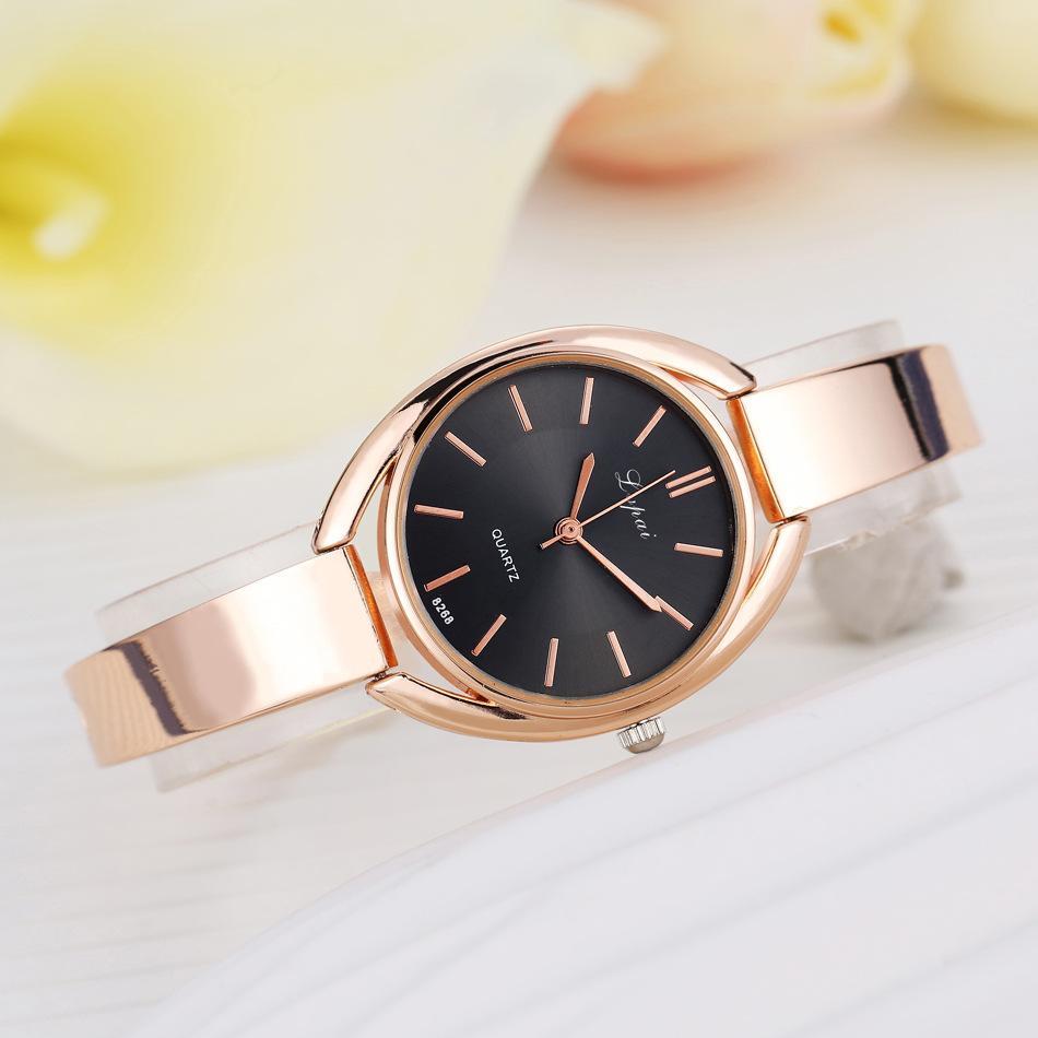 Venta al por mayor 30 unids de color mezclado de color 28 mm x 8 mm 37 g de ladies de cuarzo relojes para mujer Estudiantes de las mujeres Relojes Relojes de pulsera casual CH033