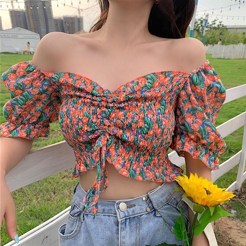 Blusas de las mujeres Estilo dulce Estilo Femenino Estampado Floral Plisado Tops Tops Sexy Slash Cuello Off Hombro Soporte Manga Camisas1