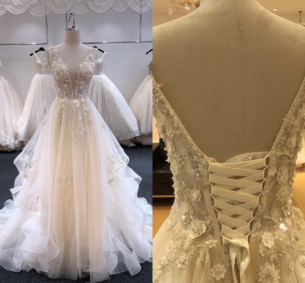 Vestido de novia de flores 3D Perlas Vestidos de boda 2021 Hundiendo V-cuello del corsé del vestido de boda del país Volver nupcial del cordón de las mujeres para la novia barato