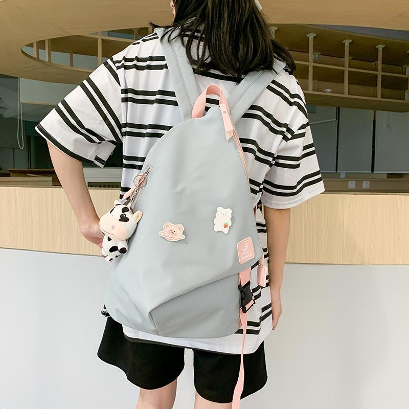 Campus Style Women Backpack 2020 New Fashion School for Teenage Girls High Quality Students Book Bag College Doll Pendant Q1113