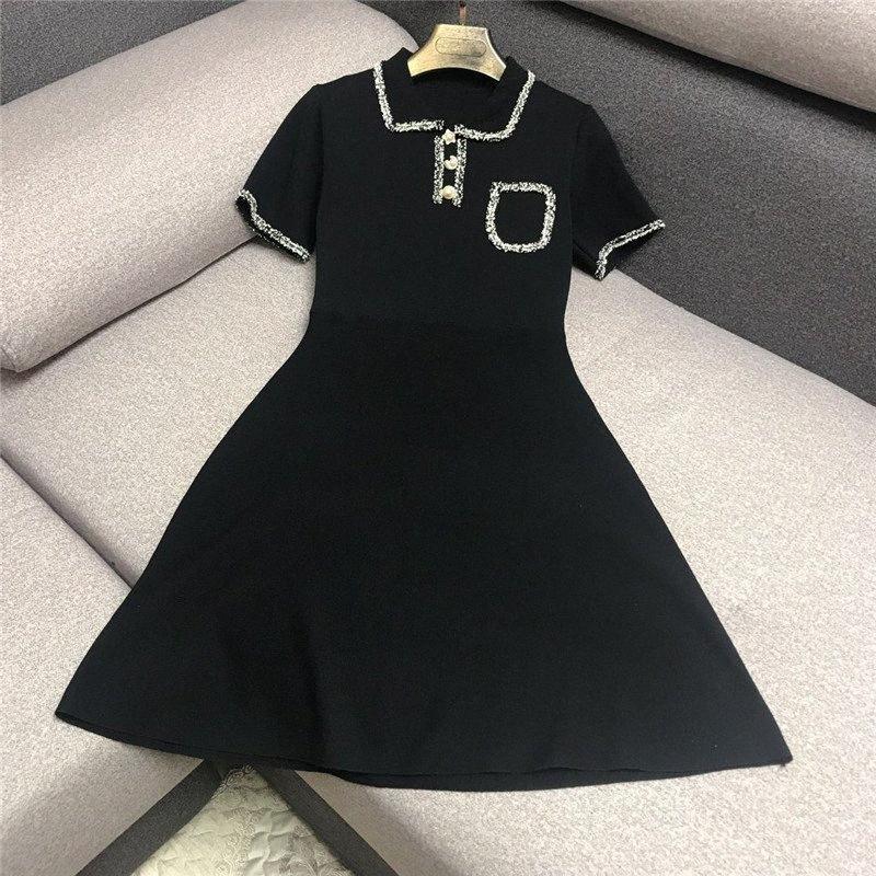 Luxus-Designermarken Strickkleid für Frauen beiläufige Puppe-Kragen-Quasten Hinter aushöhlen Hepburn Strickkleid Schwarz X9BA #