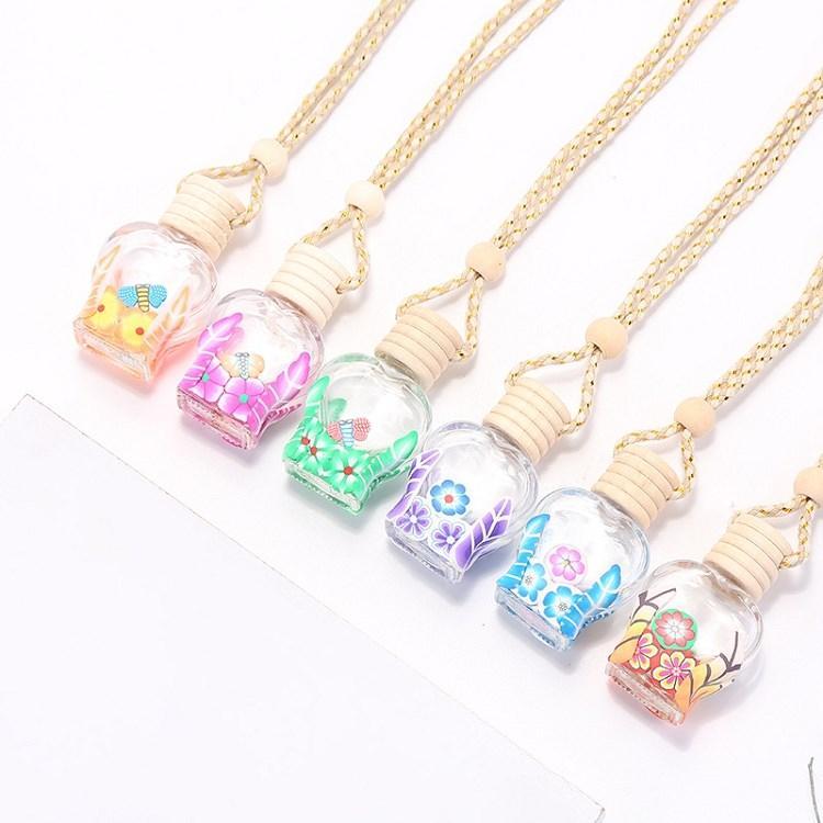 Botella de perfume del coche colorido caliente colgante esencial difusor de aceites Adornos ambientador de aire colgante del perfume Botella de cristal vacía T2I51647 regalo