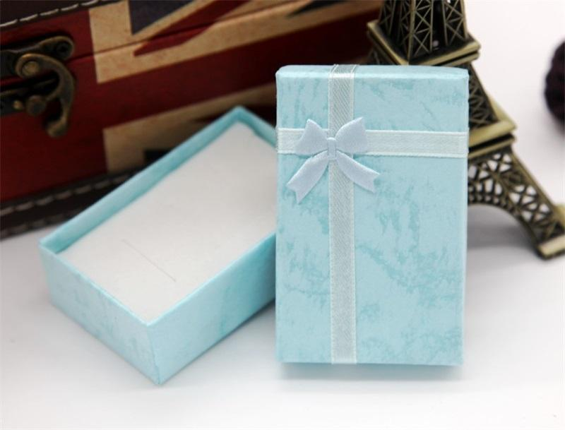 Caja de regalo de la joyería del arco de la moda Caja colorida del anillo del anillo de la pulsera del rectángulo de la carcasa del ornamento de la alta calidad Venta caliente de la alta calidad 0 51ZK L2
