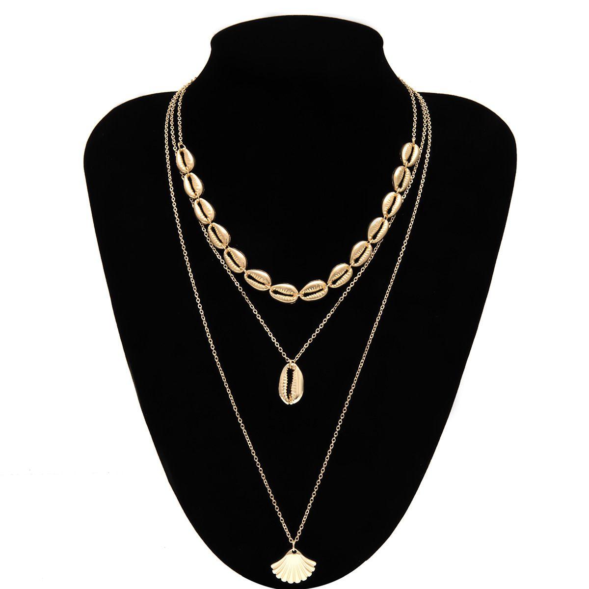 10sets / Lote Moda Vieira collares pendientes Multi Layer euro americano Cadenas Partido aleación de oro de Shell Gargantillas mujeres clavícula Cruz