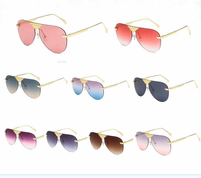 Fábrica de hombres 9color. GOOGEL DESCUENTO DE SPORT SPORT SPORTES Gafas de sol Gafas de sol para mujer 10pcs / lote Gafas Moda Qfogc