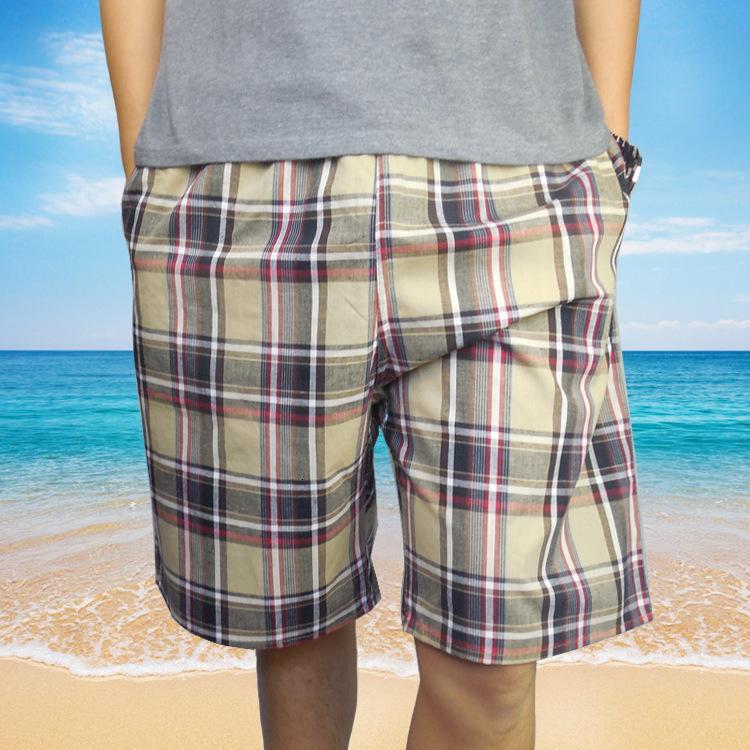 Capris de algodón para hombres Agrega 200 kg de grasa, use pantalones de playa de tela escocesa ocasionales sueltos, pantalones cortos de hogar deportivos