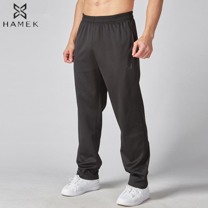 Hombres pantalón de deportes de los pantalones deportivos de las mujeres