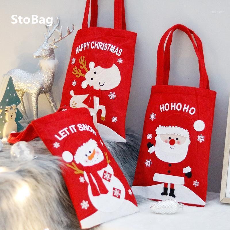 Подарочная упаковка Stobag красный 22,5 * 52см Счастливый рождественский выпускной год Конфеты упаковка поставки Санте Клауса ручки хранения сумка добра
