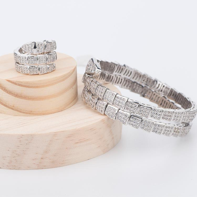 Мода личности Горячая медная инкрустация циркона дорогостоящие альтернативные двойные весенние кольца змеи регулируемое кольцо J0112