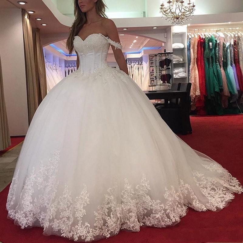 Nouveau Dubaï Arabe Plus Taille Robe De Mariée Robes De Mariée Date d'épaule Sweetheart Dentelle Appliques Perlée Cristal Gobelles de mariée Puffy Vestidos