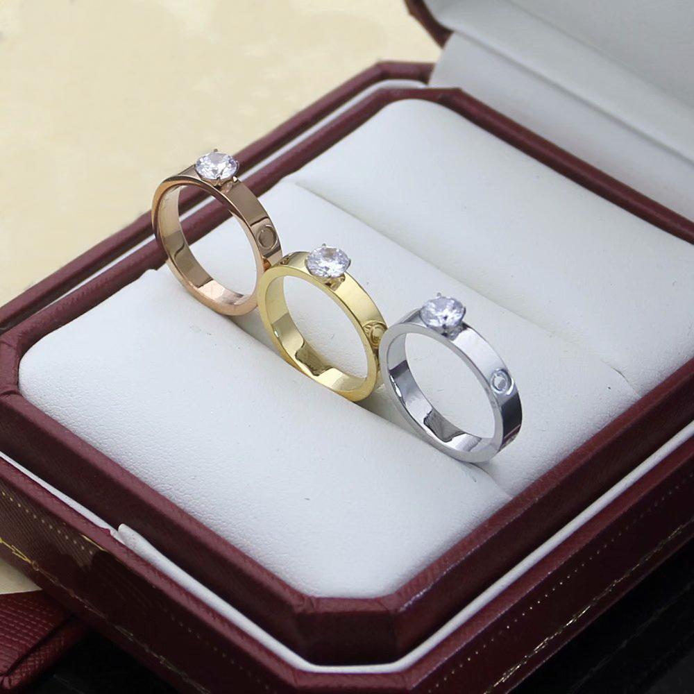 Europa América estilo hombres dama mujeres titanio acero 18k oro grabado letra cuatro punta de punta enamoradores de diamante único anillos estrechos US6-US9