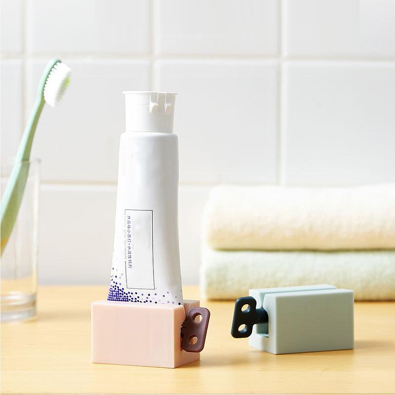 Multifuncional tubo de dentífrico Imprensa Squeezer portátil de plástico Dispenser Toothpaste Pasta de dente Titular acessório de casa de banho