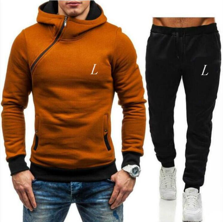 Hombres diseñadores Sudaderas con capucha Pantalones Conjunto Chándal con capucha Mens Sweat Suits Patchwork Negro Sólido Color 2021 Otoño Invierno 2 unids Sudaderas Sportsuit 3xl