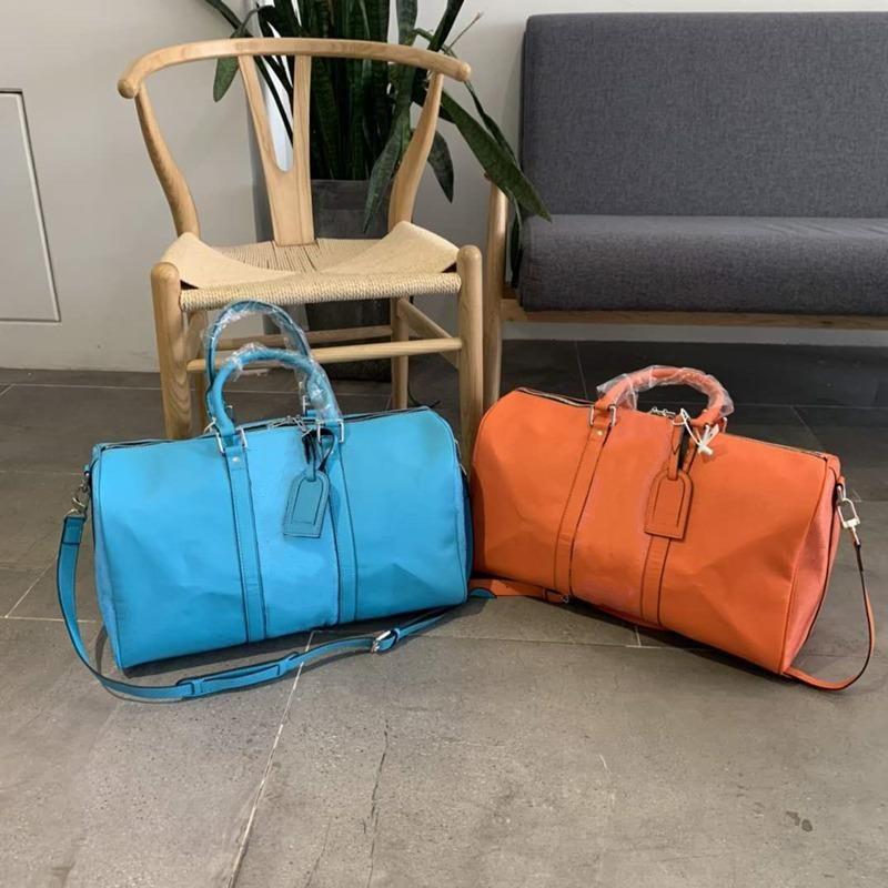 مصممون حقائب اليد سعة كبيرة حقائب الكتف إلكتروني أكياس زهرة الأزياء للجنسين حقيبة سفر سستة جلد طبيعي الرجال أكياس القماش الخشن