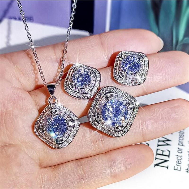 Bijoux de luxe mousseux Live Set 925 Sterling Sterling Round Cut Moissanite CZ Diamant Gémons Bague Collier Collier Boucle d'oreille pour cadeau de l'amant