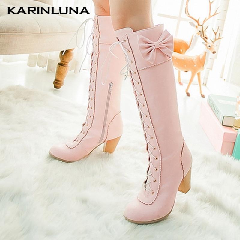 Botas Karin al Por Mayor al Por Mayor a la venta Zapatos de diseño Knee High Zip Spike Tacones Tacones de mariposa cruzada Cross-atado
