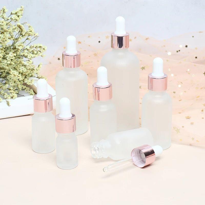 5/10/15/20 / 30 / 50ml Garrafa de óleo essencial frasco de óleo de plástico dropper sub-engarrafamento transparente com tampa de ouro rosa