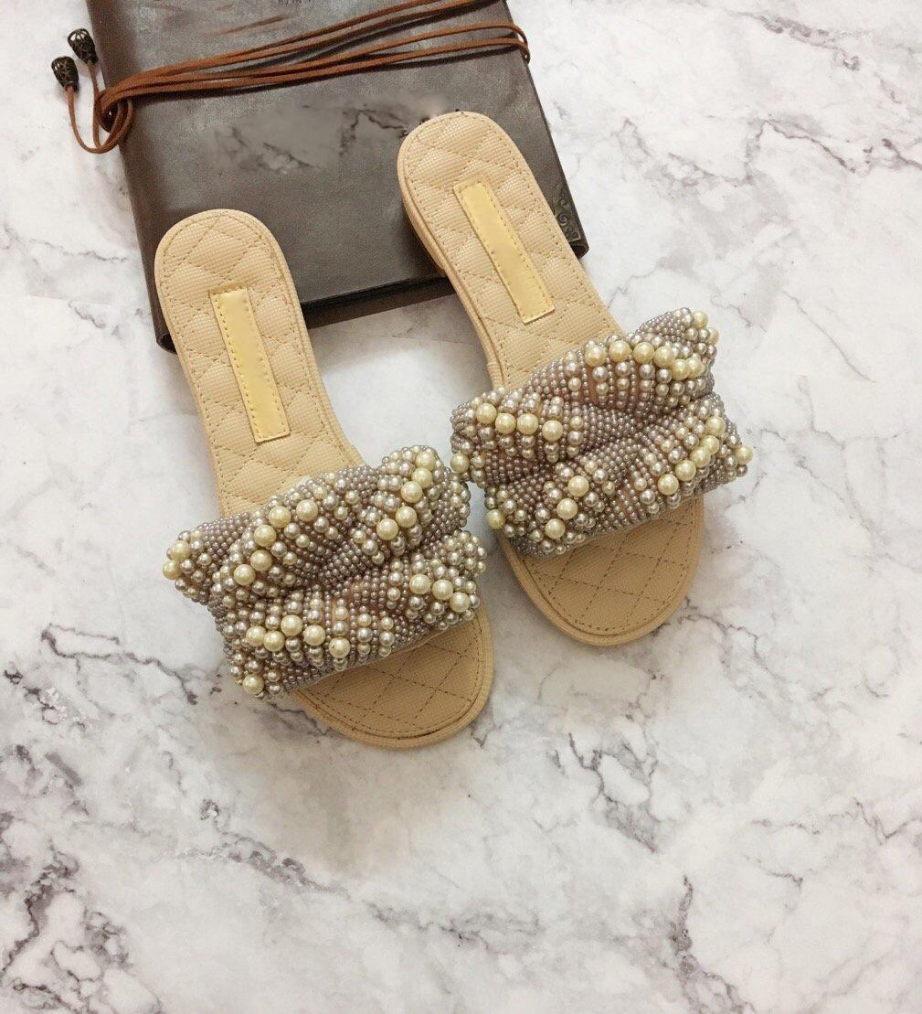 2020 primavera e verão na moda desgaste exterior sandálias de dedo Europa e América pérola plana chinelos sapatos femininos uma férias fonte