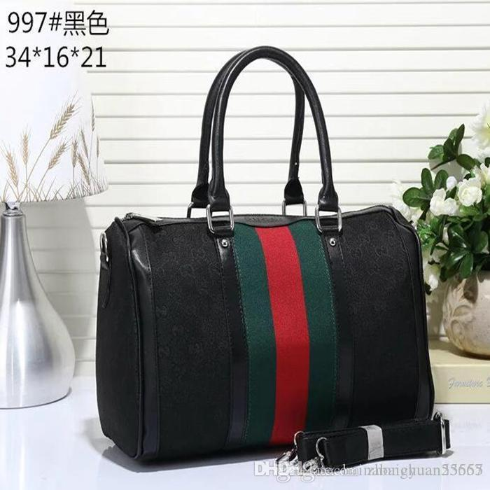 #001 01 men's women travel bags 202 sale quality men shoulder duffel bags carry on luggage bottom rivets with lock head