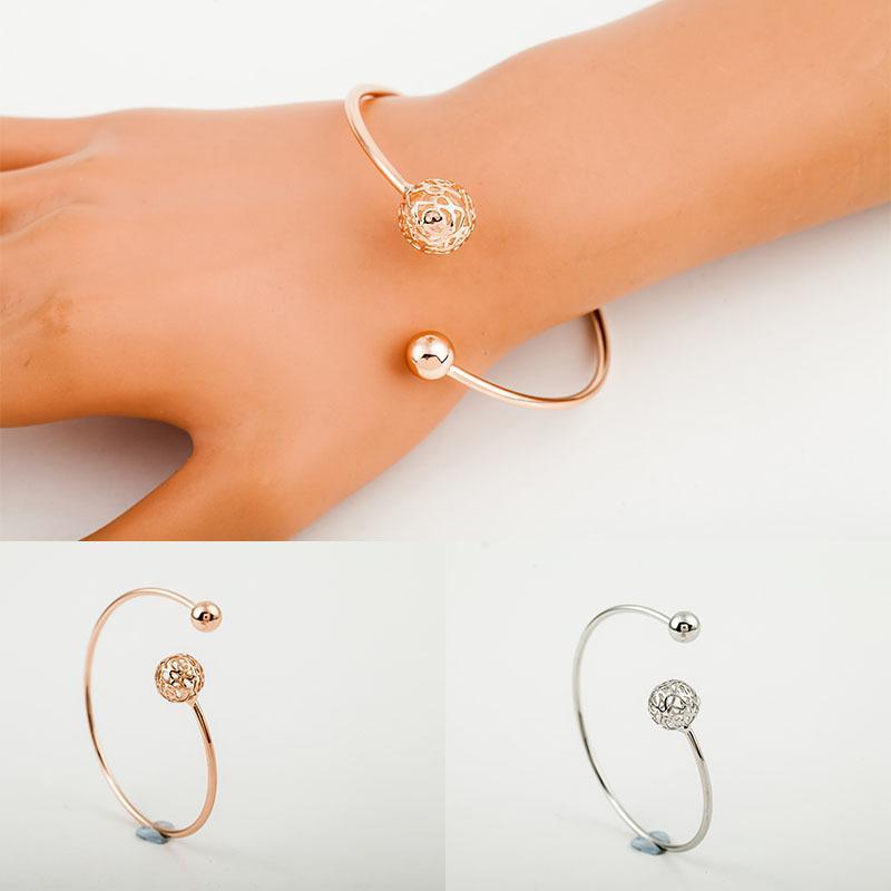 Figura asimétrica hueco bola de apertura ajustable de las pulseras de plata plateado metálico de oro de los brazaletes para las mujeres