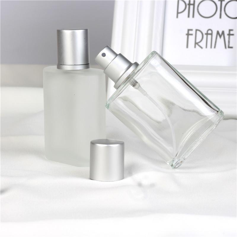 Venda quente 1 peça 30ml Forma de vidro portátil frasco de perfume de vidro com atomizador de alumínio Recipiente cosmético vazio para Travel1