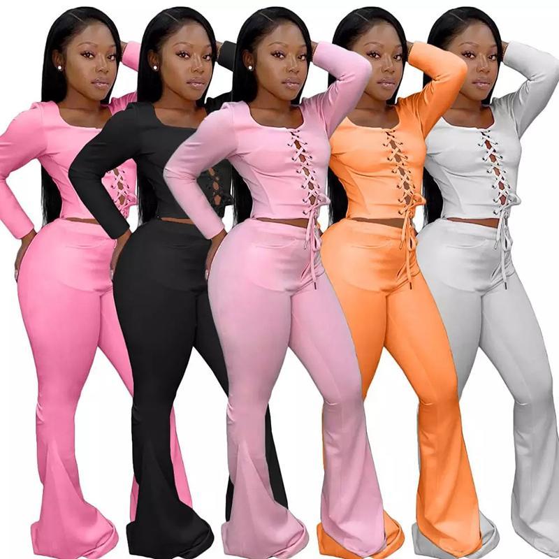 Manches longues Grommet Lace Up Top Crop et Flare Pants Deux Piece Set Tenues Survêtement Femmes Fitness Costume Active Wear