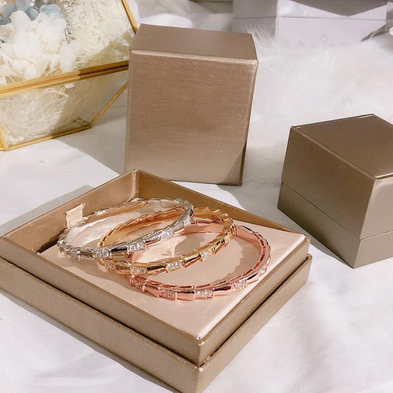 Venta de la manera de señora Women de latón chapado en oro de 18 quilates de diamante completo y suave Forma Spaced diamante serpiente Reduzca pulseras brazalete
