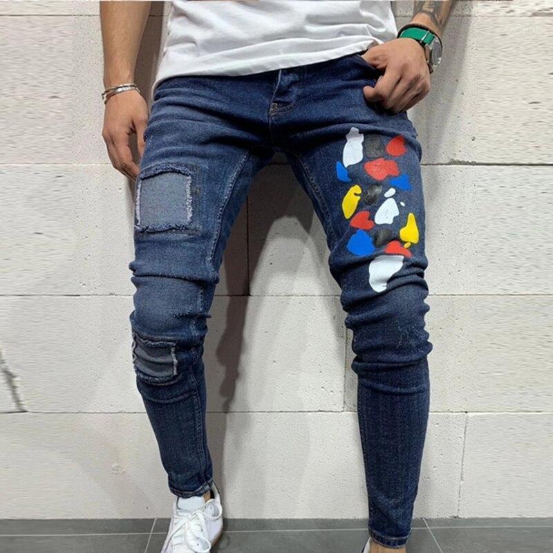 Мужчины разорванные джинсы тонкие пригодные джинсовые брюки Biker хип-хоп джинсы дыра приклеенные красочные точечные печати тощий огорченный джинсовый брюк