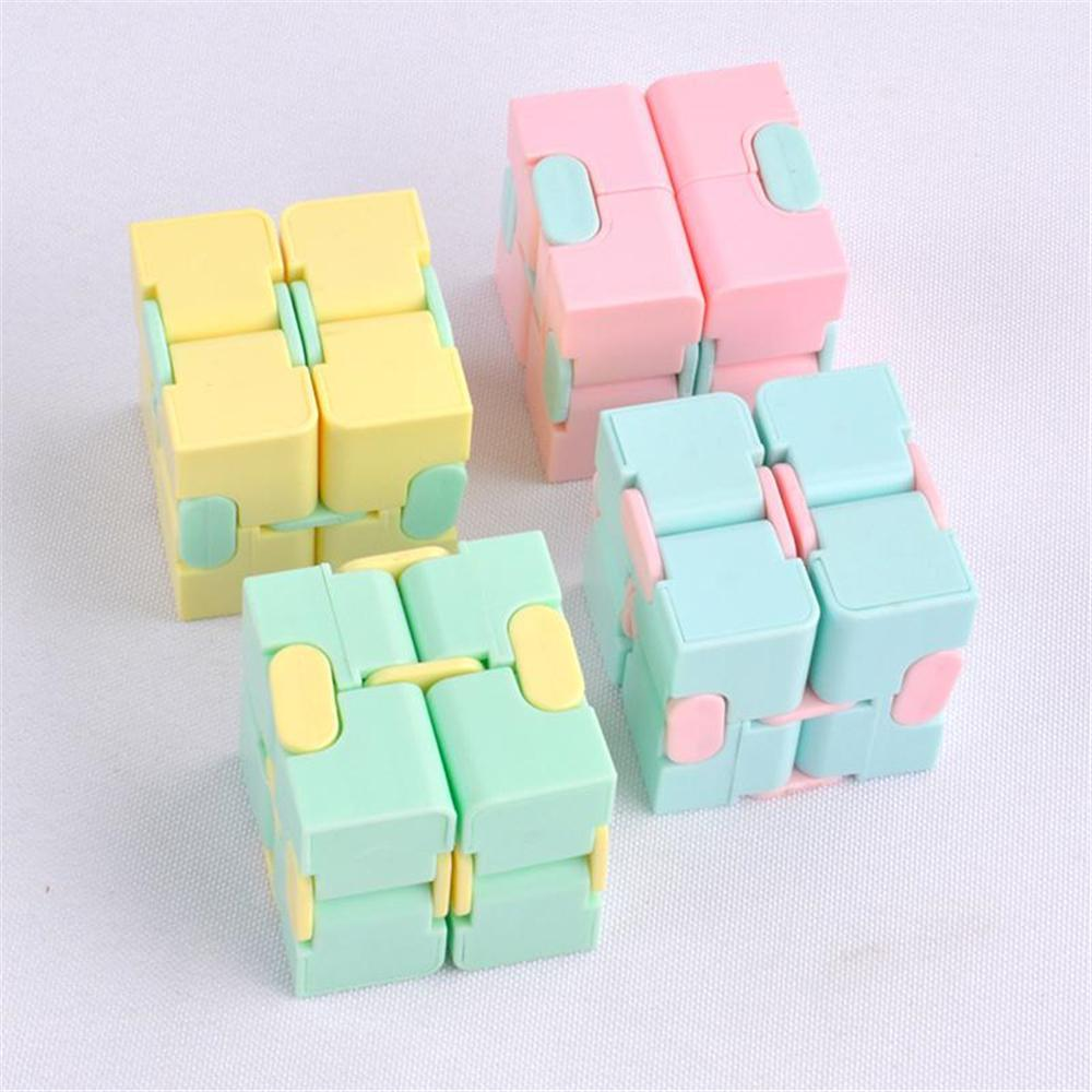 Nuevo infinito cubo Color Color Fidget Cube anti estrés Cubo dedo Dedo Spinners Divertidos juguetes para niños adultos Adhd ADHD Alivio del estrés Juguete